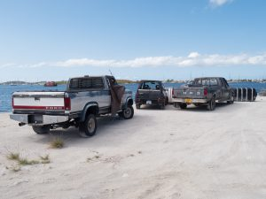 Old Trucks alongside Simpson Bay Lagoon